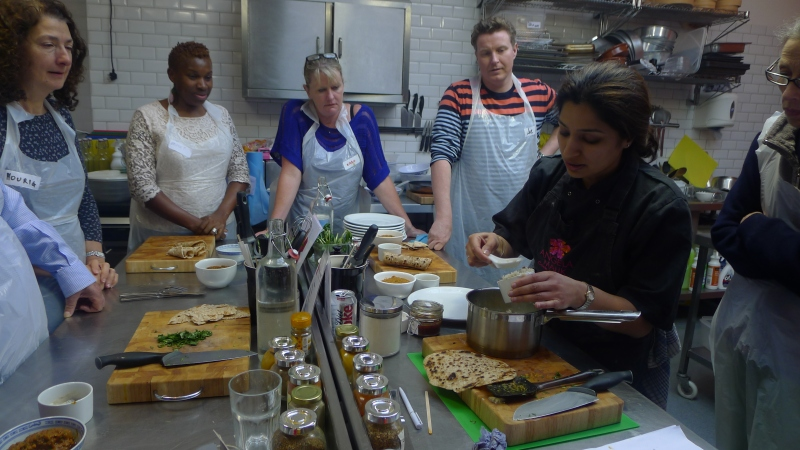 Angela Malik shows the class how to dish up our Thali