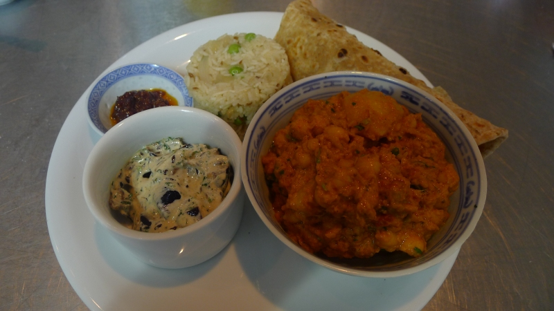 Our Thali, clockwise from top left: chilli jam; caramelised onion and peas pulao; chapatti; channa masala; aubergine raita