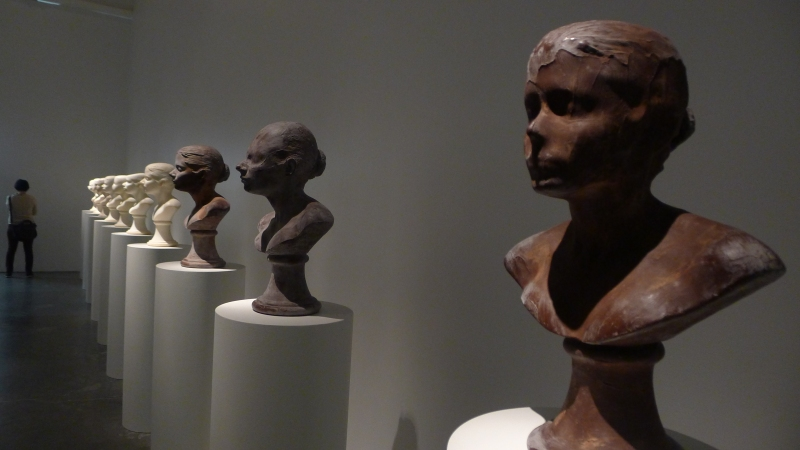 'Lick and Lather' by Janine Antoni. These are made of soap and chocolate and the artist would lick or lather them to remodel the busts