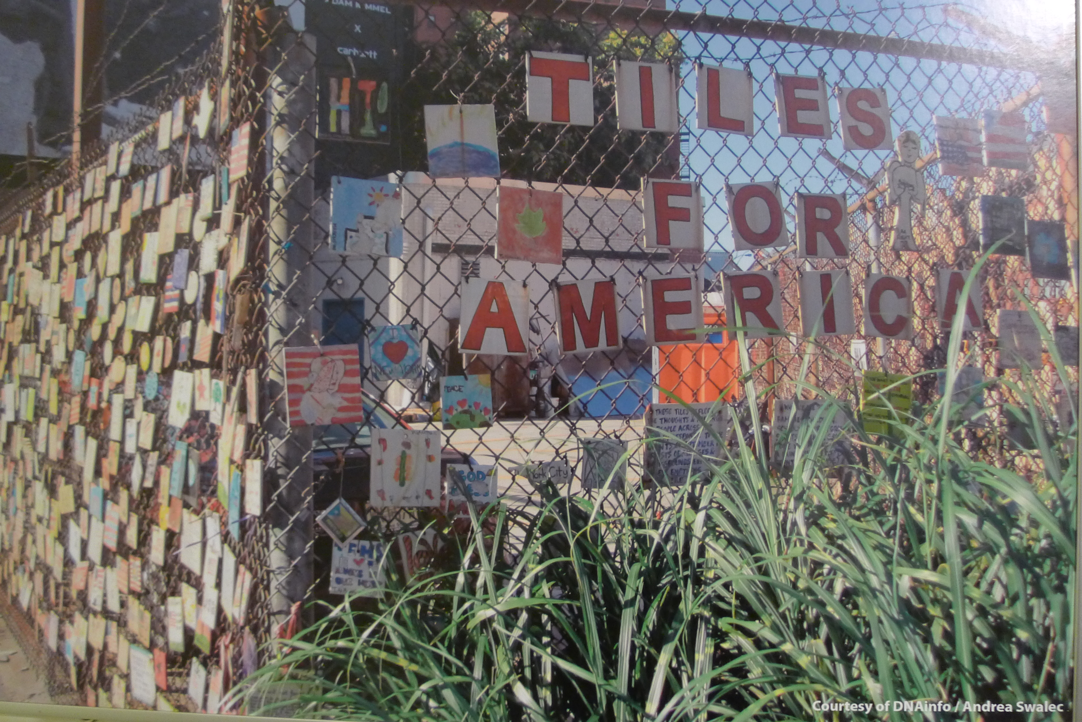 Tiles for America hanging on a fence in the West Village before they were removed